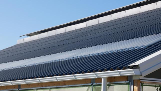 Plaques ondulées en fibres-ciment SVK pour couverture de toiture en vente chez Glaesener-Betz